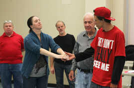 "Army veteran Carissa DiPietro takes the hand of Iraq war veteran Mike Mitchels while rehearsing for ""Julius Caesar"" in Milwaukee. A group of actors is using William Shakespeare's plays to help veterans with emotional and addiction issues heal, Sept."