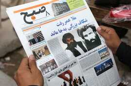 FILE - An Afghan man reads a local newspaper carrying a headline about the new leader of the Afghan Taliban, Mullah Akhtar Mansoor, in Kabul, Afghanistan, Aug. 1, 2015.