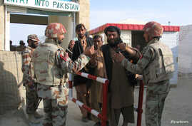 Pakistani soldiers check the identity of citizens returning from Afghanistan at the border town of Chaman, Pakistan, March 7, 2017.