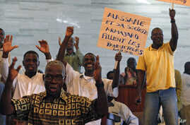People protest against the European Union in Abidjan, and Ivory Coast cocoa exporters said they feared for their future after presidential claimant Alassane Ouattara said he would extend one-month cocoa export ban if his rival refuses to leave power,