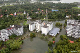 An aerial view shows partially submerged buildings at a flooded area in the southern state of Kerala, India, Aug. 19, 2018.
