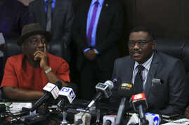 Nigeria's Minister of Health Onyebuchi Chukwu (R) speaks at a media briefing about the Ebola outbreak in Nigeria, while Interior Minister Abba Moro looks on, at the health minister's office in Abuja, Nigeria, August 14, 2014.