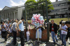A man sells cotton candy in front of a polling station for the municipal elections in Sao Paulo, Brazil, Oct. 2, 2016.