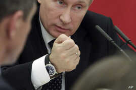 In this Monday, Nov. 12, 2012 photo, Russian President Vladimir Putin heads a meeting in Moscow.