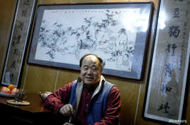 """Chinese writer Mo Yan smiles during an interview at his house in Beijing December 24, 2009. Mo Yan won the 2012 Nobel prize for literature on October 11, 2012 for works which the awarding committee said had qualities of """"hallucinatory realism""""."""