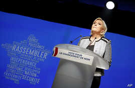 FILE - French far-right leader Marine Le Pen gestures as she delivers a speech to announce a name-change for her National Front party, in Bron, central France, June 1, 2018.