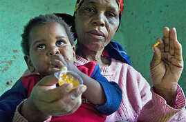 HIV positive child  is given some jam prior to her ARV medication by a care giver near Durban South Africa, November 2010 (file photo)