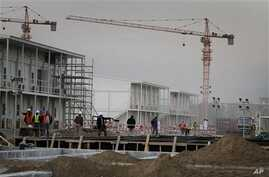 Construction workers walk at the area under construction at the US embassy in Kabul, Afghanistan (File Photo)