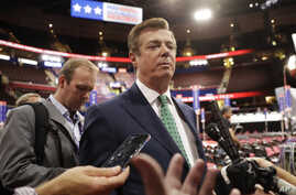FILE - Paul Manafort talks to reporters on the floor of the Republican National Convention at Quicken Loans Arena in Cleveland.