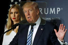 FILE - Then-Republican presidential nominee Donald Trump and his daughter Ivanka Trump attend a campaign event in Washington.