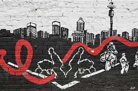A wall mural in downtown Johannesburg shows a city skyline with an AIDS ribbon passing through workers who make a living in the town, 23 Nov 2010