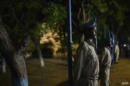 A handout photo taken and released on July 1, 2014 by the African Union-United Nations Information Support Team shows members of the Somali Police Force standing guard during an Independence Day ceremony in Mogadishu, Somalia.