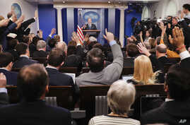 FILE - reporters raise their hands as White House press secretary Sean Spicer takes questions during the daily briefing in the Brady Press Briefing Room of the White House in Washington.