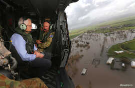 Australian Prime Minister Malcolm Turnbull looks at damaged and flooded areas from aboard an Australian Army helicopter after Cyclone Debbie passed through the area near the town of Bowen, south of the northern Queensland town of Townsville in Austra...