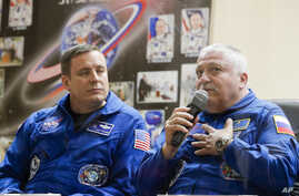 Russian cosmonaut Fyodor Yurchikhin, right, speaks as U.S. astronaut Jack Fischer listens during a news conference in Kazakhstan, April 19, 2017.
