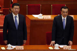 China's President Xi Jinping (L) and Premier Li Keqiang arrive at the closing ceremony of the Chinese People's Political Consultative Conference at the Great Hall of the People in Beijing, Mar. 12, 2014.