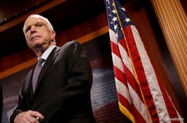 "FILE - Senator John McCain (R-Az.) looks on during a press conference about his resistance to the so-called ""Skinny Repeal"" of the Affordable Care Act on Capitol Hill in Washington, July 27, 2017."