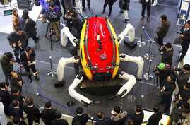 Visitors look at an undersea exploration robot during a drone show at the BEXCO Exhibition Hall in the southeastern port city of Busan on January 19, 2017.