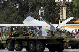 Military vehicles carrying Wing Loong, a Chinese-made medium-altitude long-endurance unmanned aerial vehicle, take part in a military parade in Beijing, Sept. 3, 2015.
