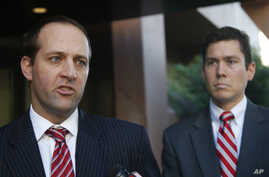 Assistant U.S. Attorneys Mark Pletcher, left, and Robert Huie, talk outside the federal courthouse, about the guilty plea of Leonard Francis, known in military circles as Fat Leonard, on bribery charges involving U.S. Navy officials Thursday, Jan. 15