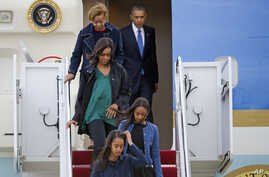 President Barack Obama exits Air Force One with his family, March 25, 2016, at Andrews Air Force Base, Md.