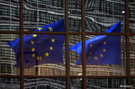 A European flag reflects in a building of the EU headquarters in Brussels. (File)