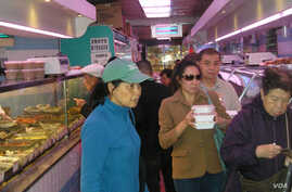 Shoppers at a food store in New York City's Manhattan Chinatown