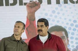 Venezuelan President Nicolas Maduro (R) and his Vice President Tareck El Aissami participate in a rally with workers of PDVSA state-owned oil company in Caracas, Jan. 31, 2017.