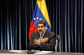 Venezuela's President Nicolas Maduro gestures as he talks to the media during a news conference at Miraflores Palace in Caracas, Venezuela, Sept. 18, 2018.