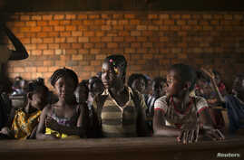 FILE - Students are seen in a classroom at a school in the capital of the Central African Republic, Bangui, Mar. 18, 2014.