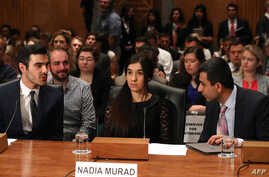 Nadia Murad, (C), human rights activist, testifies during Senate Homeland Security and Governmental Affairs Committee hearing on Capitol Hill, June 21, 2016 in Washington, DC.