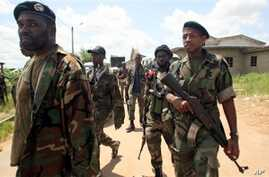 Soldiers from the 'Invisible Commandos', loyal to Ibrahim Coulibaly, walk in the PK-18 area of the Abobo neighborhood, in Abidjan, Ivory Coast, April 25, 2011