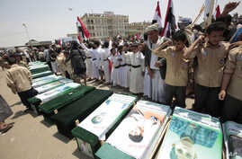 FILE - Yemeni people attend the funeral of victims of a Saudi-led airstrike, in Saada, Yemen, Aug. 13, 2018. Yemen's Shi'ite rebels are backing a United Nations' call for an investigation into the airstrike in the country's north that killed dozens o...