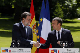 French President Emmanuel Macron and Spain's Prime Minister Mariano Rajoy attend a joint press conference after their meeting at the Elysee Palace in Paris, France, June 16, 2017.