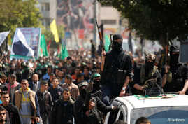 Palestinian members of Hamas' armed wing take part in the funeral of senior militant Mazen Fuqaha in Gaza City, March 25, 2017.