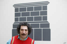 FILE - Artist Michael Rakowitz poses for the media at the National Gallery in London, March 21, 2017.