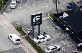 Investigators work the scene following a mass shooting at the Pulse gay nightclub in Orlando Florida, U.S., June 12, 2016.