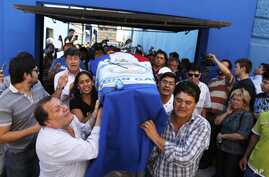 Relatives carry a coffin with the remains of Rodrigo Quintana, a member of the Authentic Radical Liberal Party, who was killed in an incident at party's headquarters away from congress at the party's headquarters on Friday, in Asuncion, Paraguay, Apr