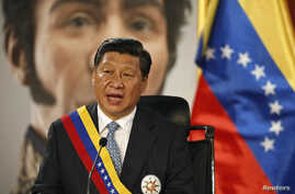 China's President Xi Jinping attends a meeting with Venezuela's President Nicolas Maduro (unseen) at Miraflores Palace in Caracas July 20, 2014. A large portrait of Latin American political and military leader Simon Bolivar is seen in the back.  REUT