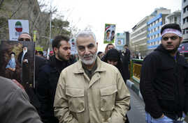 FILE - Revolutionary Guard General Qassem Soleimani attends an annual rally commemorating the anniversary of the 1979 Islamic revolution, in Tehran, Iran, Feb. 11 2016.