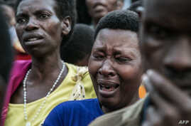 Women grieve during the burial of seven miners, victims of a collapsed mine, at the Ntunga public cemetery in Rwamagana, eastern Rwanda, on Jan. 22, 2019.