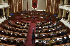 Albania's Prime Minister Edi Rama delivers a speech to the parliament with the seats of the main opposition Democratic party, left, empty, during an assembly session in Tirana, Feb. 23, 2017.