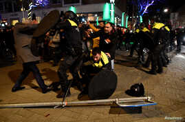 Riot police clash with demonstrators in the streets near the Turkish consulate in Rotterdam, Netherlands, March 12, 2017.