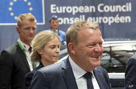 Danish Prime Minister Lars Lokke Rasmussen, right, arrives for an EU summit in Brussels on Tuesday, June 28, 2016.  Rasmussen said his minority government would push ahead with a bill to reject asylum seekers at the borders in times of crisis even th