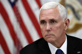 Vice President Mike Pence listens in the Vice President's Ceremonial Office on the White House complex in Washington, during a meeting with family members of the six Citgo executives currently detained in Venezuela, April 2, 2019.