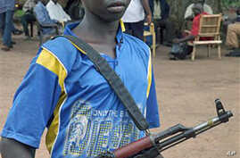 A rebel Lord's Resistance Army boy soldier stands at the Sudan/DRC border (File)
