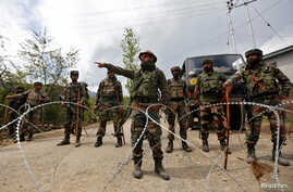FILE - Indian army soldiers stand guard inside their army base after it was attacked by suspected separatist militants in Panzgam in Kashmir's Kupwara district, April 27, 2017.