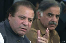 FILE -  In this Feb. 17, 2008 file photo, Pakistan's Prime Minister Nawaz Sharif, left, and his brother Shahbaz Sharif address a news conference in Lahore, Pakistan. Sharif has announced that he will set up an independent judicial commission to probe