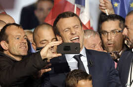 Independent centrist presidential candidate Emmanuel Macron reacts as a photo is taken after his speech during a campaign meeting in Marseille, France, April, 1, 2017. The two-round presidential election is set for April 23 and May 7.