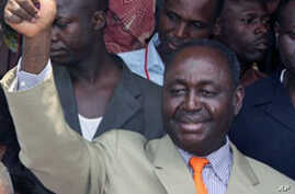 President Francois Bozize gives a thumbs up after voting on January 23, 2011